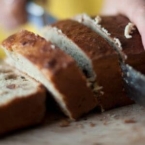 Woman slicing a fresh baked banana quark bread
